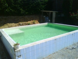 Piscines hors sol bois for Piscine a debordement kit